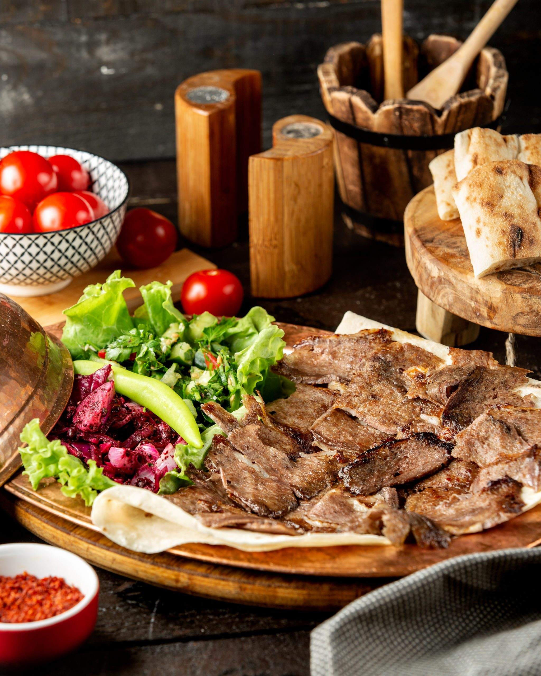lamb doner slices served with vegetable salad and flatbread